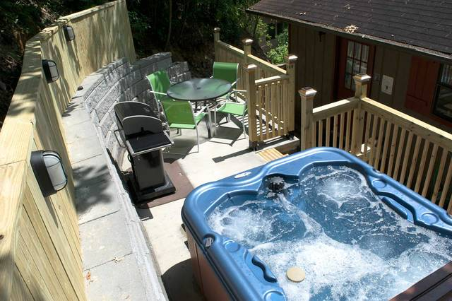 Relax in the hot tub of this Gatlinburg Chalet